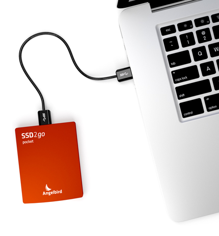 Red SSD2go pocket and a laptop